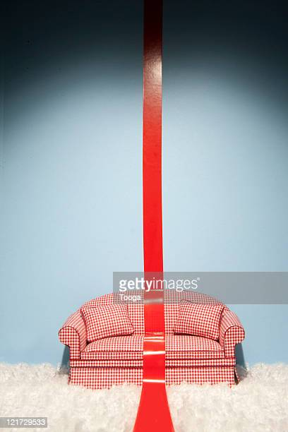 Couch with red tape down the center