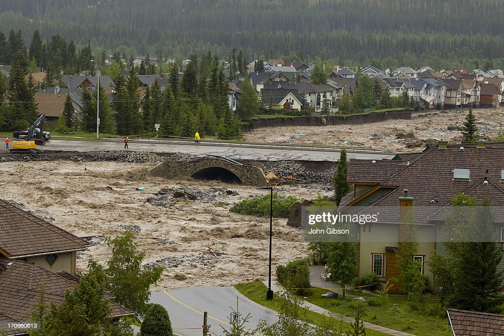 Cougar Creek takes out Eagle Terrace Road and breaches Elk Run Blvd Bridge June 20 2013 in Canmore Alberta Canada Widespread flooding caused by...