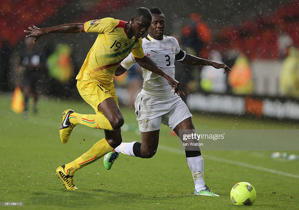 Coulibaly Salif Tidiane of Mali challenges Gyan Asamoah of Ghana during the 2013 Africa Cup of Nations Third Place Play-Off match between Mali and Ghana on February 9, 2013 in Port Elizabeth, South Africa.