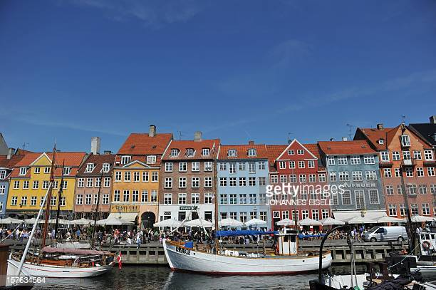 Coulourful houses and boats can be seen in the Nyhavn district in Copenhagen on August 10 2010 Denmark will play against Germany in a friendly...