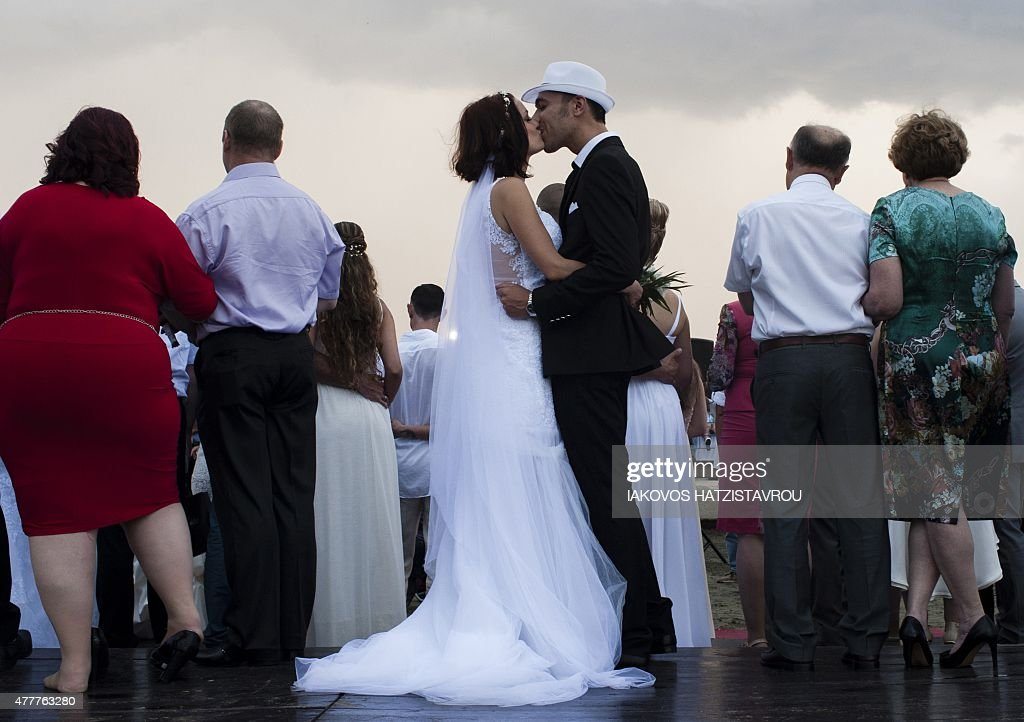 coulpe kisses during a mass civil wedding ceremony for foreign ...