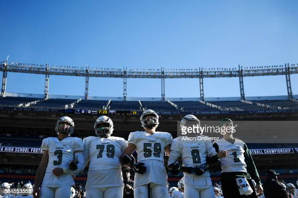 Coulter of Pine Creek Eagles Christion Louis Tanner Rheinblot Xavier Hill and Wyatt Wieland stand before the coin toss against Pueblo South during...