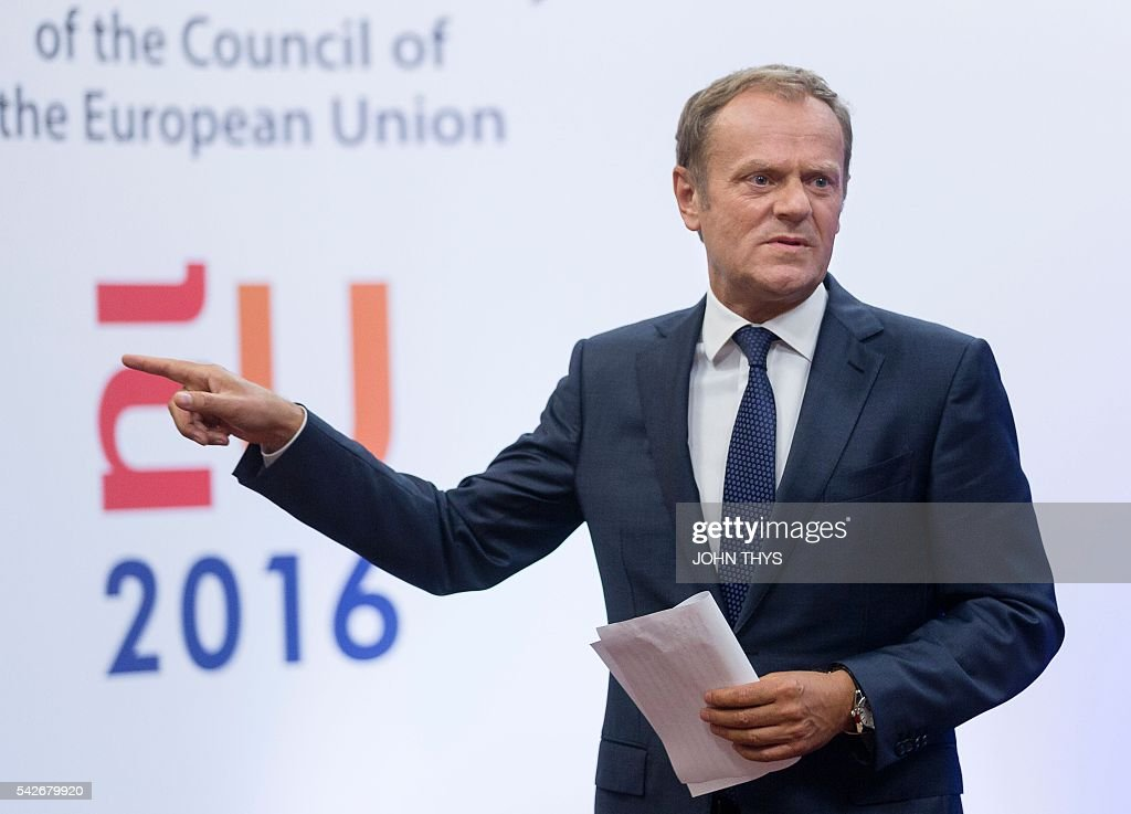EU Council President <a gi-track='captionPersonalityLinkClicked' href=/galleries/search?phrase=Donald+Tusk&family=editorial&specificpeople=870281 ng-click='$event.stopPropagation()'>Donald Tusk</a> leaves after a statement on Brexit at the EU Headquarters in Brussels on June 24, 2016. Britain has voted to break out of the European Union, striking a thunderous blow against the bloc and spreading panic through world markets on June 24 as sterling collapsed to a 31-year low. / AFP / JOHN