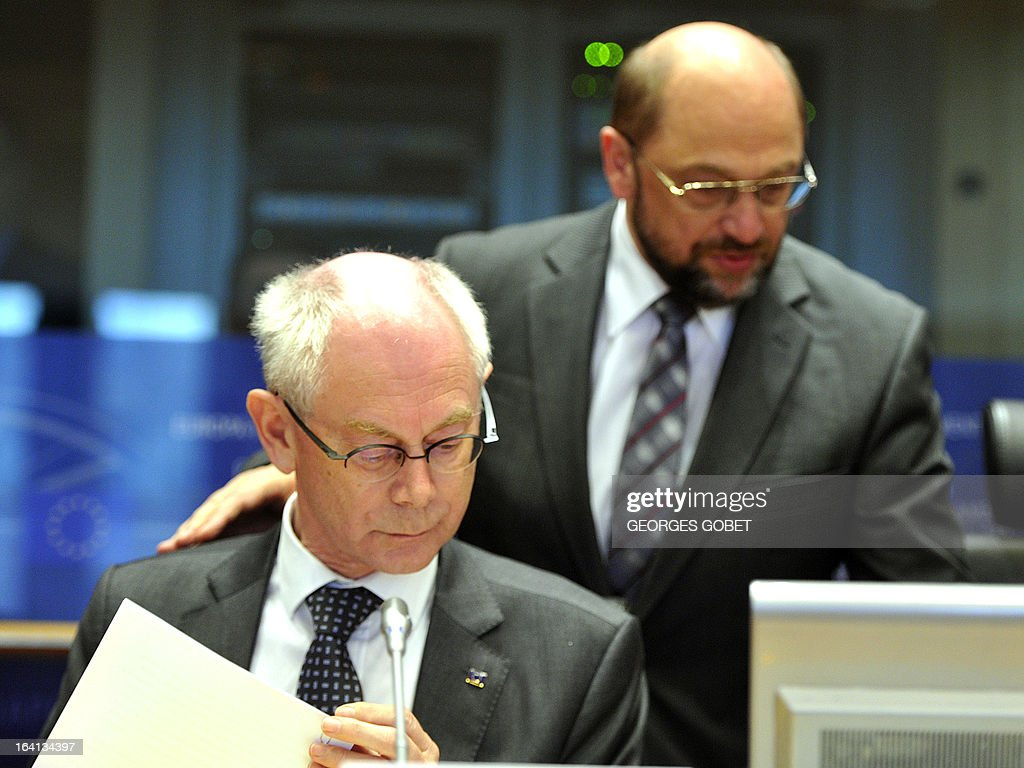 EU Council president Herman Van Rompuy and European Parliament President Martin Schulz give a statement on March 20, 2013 during a meeting with members of EU Parliament for the report of the last European Council at the EU Headquarters in Brussels. Parliament hosts a post-summit debate on EU economic policy with EP President Martin Schulz, political group leaders, European Council President Van Rompuy and Commission President Barroso. The EU's long-term budget is also likely to feature, ahead of negotiations to take place between Parliament and Council. AFP PHOTO GEORGES GOBET