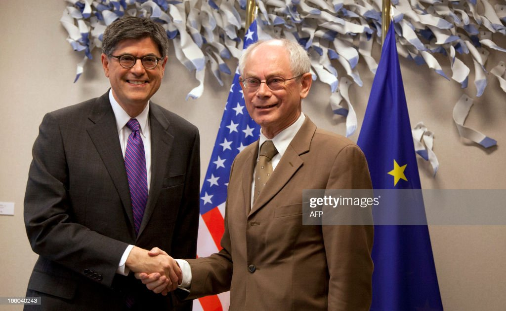 EU Council president Herman Van Rompuy (R) and US States Secretary of Treasury Jack Lew (L) shake hands prior to a working session on April 8, 2013 at the EU Headquarters in Brussels.