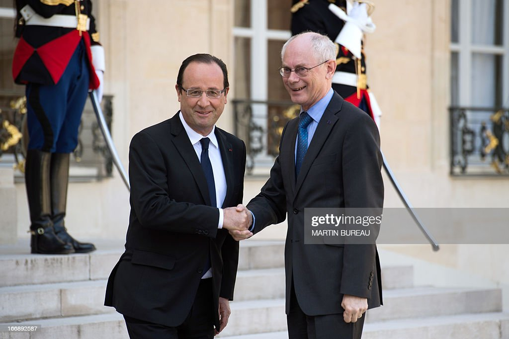 EU Council president Herman Van Rompuy (R) shakes hands with French president Francois Hollande (L) upon his arrival at the Elysee Palace on April 18, 2013 in Paris.