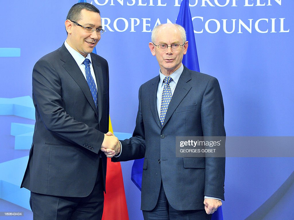 EU Council president Herman Van Rompuy (R) shakes hands with Romania's Prime Minister Victor Ponta (L) prior to a working session on February 4, 2013 at the EU Headquarters in Brussels. AFP PHOTO GEORGES GOBET