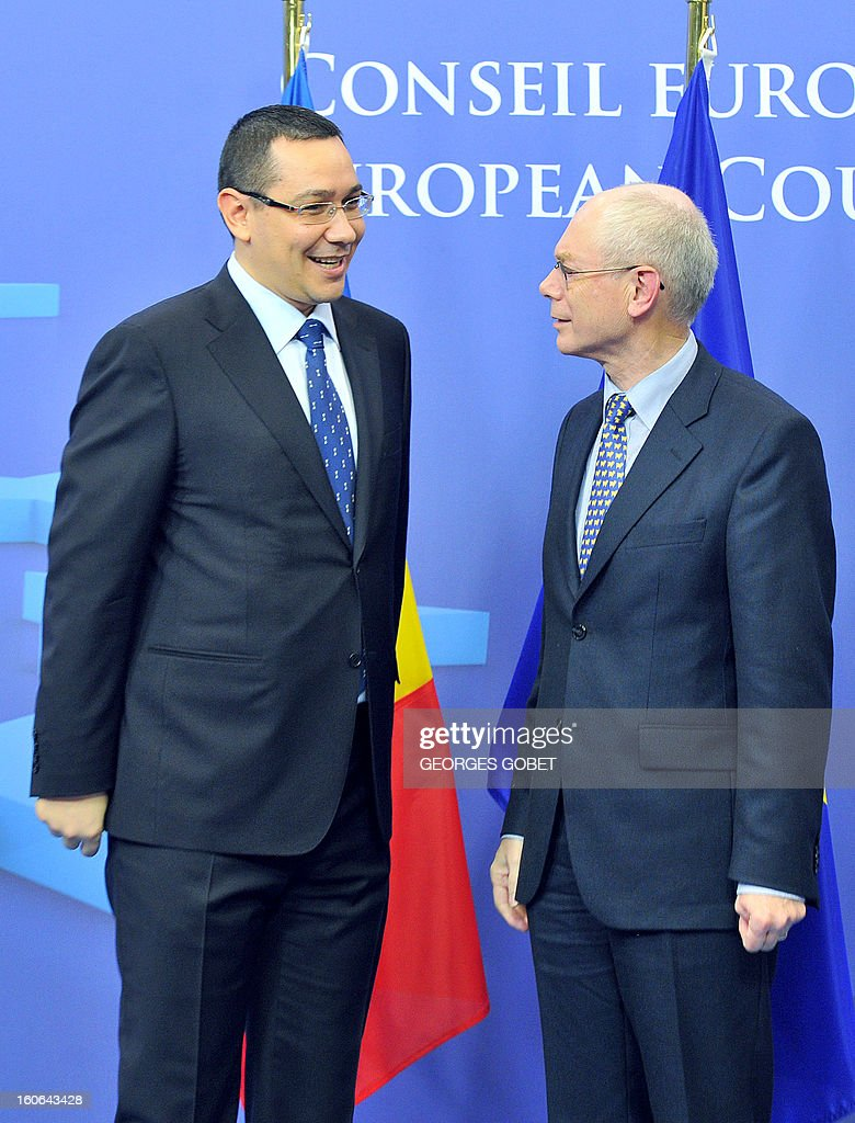 EU Council president Herman Van Rompuy (R) talks to Romania's Prime Minister Victor Ponta (L) prior to a working session on February 4, 2013 at the EU Headquarters in Brussels.