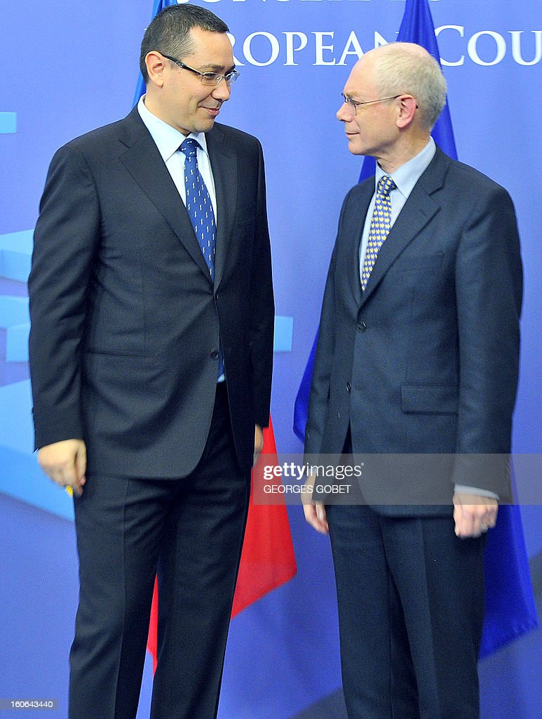 EU Council president Herman Van Rompuy (R) talks to Romania's Prime Minister Victor Ponta (L) prior to a working session on February 4, 2013 at the EU Headquarters in Brussels. AFP PHOTO GEORGES GOBET