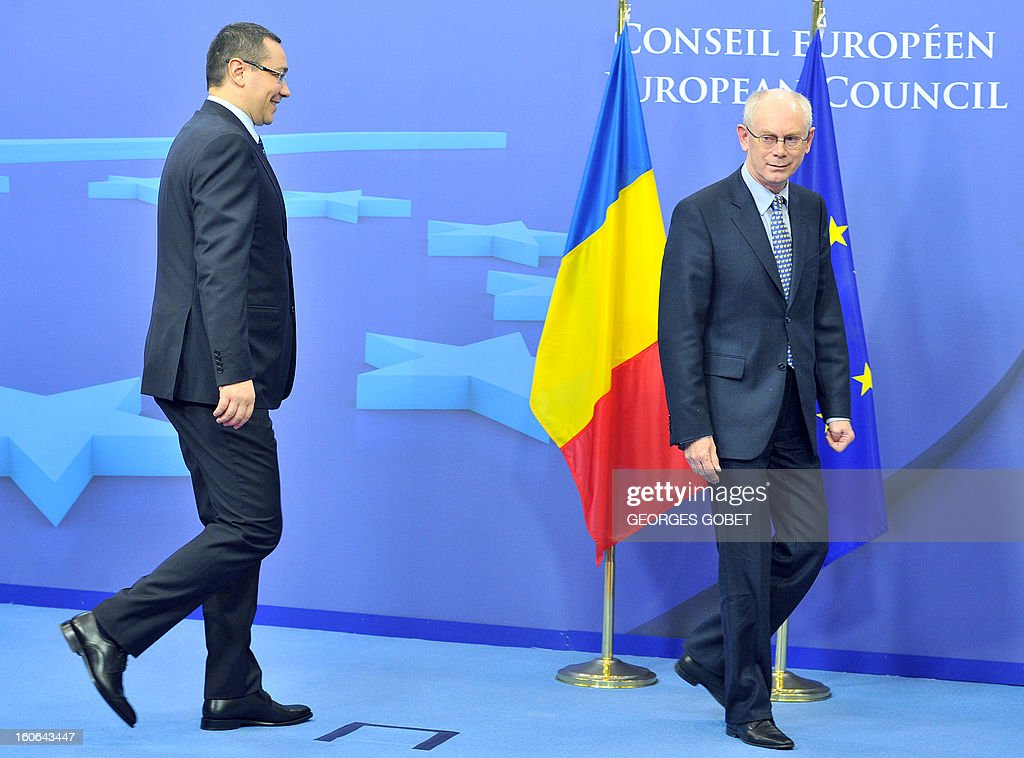 EU Council president Herman Van Rompuy (R) welcomes Romania's Prime Minister Victor Ponta (L) prior to a working session on February 4, 2013 at the EU Headquarters in Brussels. AFP PHOTO GEORGES GOBET