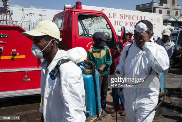 Council workers ready to start the cleanup operation of the market of Anosibe in the Anosibe district one of the most unsalubrious district of...