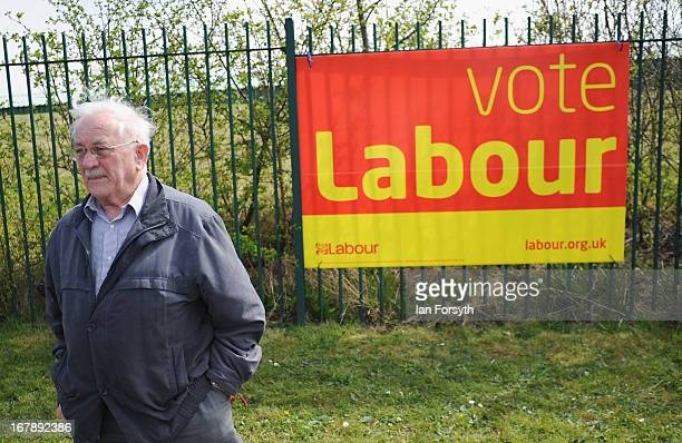 Councillor Bill Brady walks in front of a Labour party banner near to Harton and Westoe Colliery Welfare Club on the day that voters go to the polls...
