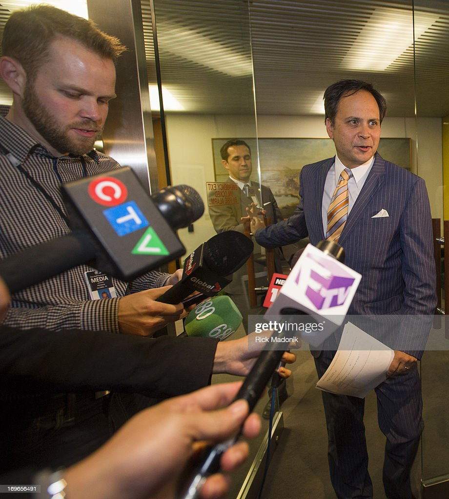 Councillor Denzil Minnan-Wong, arrives to speak to the media after a morning meeting with city staff in the Mayor's office (Mayor was not present) to discus the overnight rain and flooding issues. Minnan-Wong is Chair of Public Works and Infrastructure committee.Toronto Mayor Rob Ford arrives at City Hall office just after noon on Wednesday, May 29, 2013. Mayor Rob Ford is currently facing allegations that he was recorded on a cellphone video smoking crack cocaine and making offensive remarks.