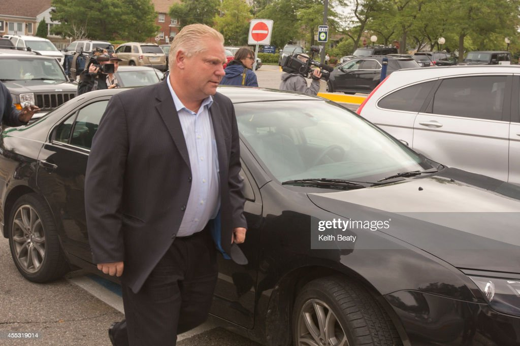 Councillor <a gi-track='captionPersonalityLinkClicked' href=/galleries/search?phrase=Doug+Ford+-+Politician&family=editorial&specificpeople=10957178 ng-click='$event.stopPropagation()'>Doug Ford</a> arrives at Humber River Regional Hospital Thursday morning to visit his brother, Toronto mayor Rob Ford, who was admitted to the hospital and diagnosed with a tumor yesterday.