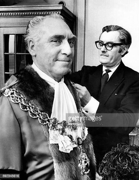 Councillor James Eames being robed by his attendant Mr Tom Freer before being elected Lord Mayor of Birmingham Eames is a 57yearold engine driver...