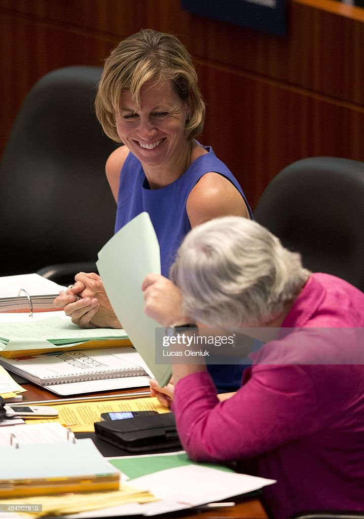 Councillor Karen Stintz shared a laugh with Councillor Sarah Doucette Monday afternoon at city hall. Toronto City Hall saw a boost of colour on Monday after a group of councillors wore pink to celebrate their last council session before the election and to protest against Rob Fords performance as mayor. August 25, 2014.