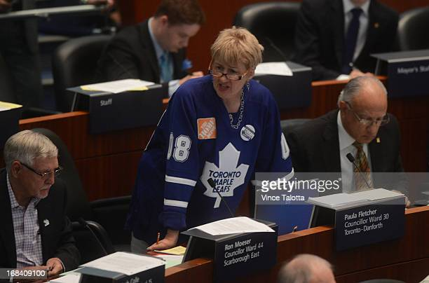 Councillor Paula Fletcher Maple Leaf fan at a City Hall council meeting which will include a debate on taxes for transit and Porter Airlines jets