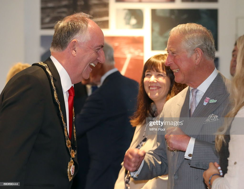 Councillor Trevor Wilson (left) speaks with Prince Charles, Prince of Wales during a tour of the new visitor centre in Bellaghy, dedicated to poet Seamus Heaney during their visit on May 9, 2017 in Bellaghy, Northern Ireland.