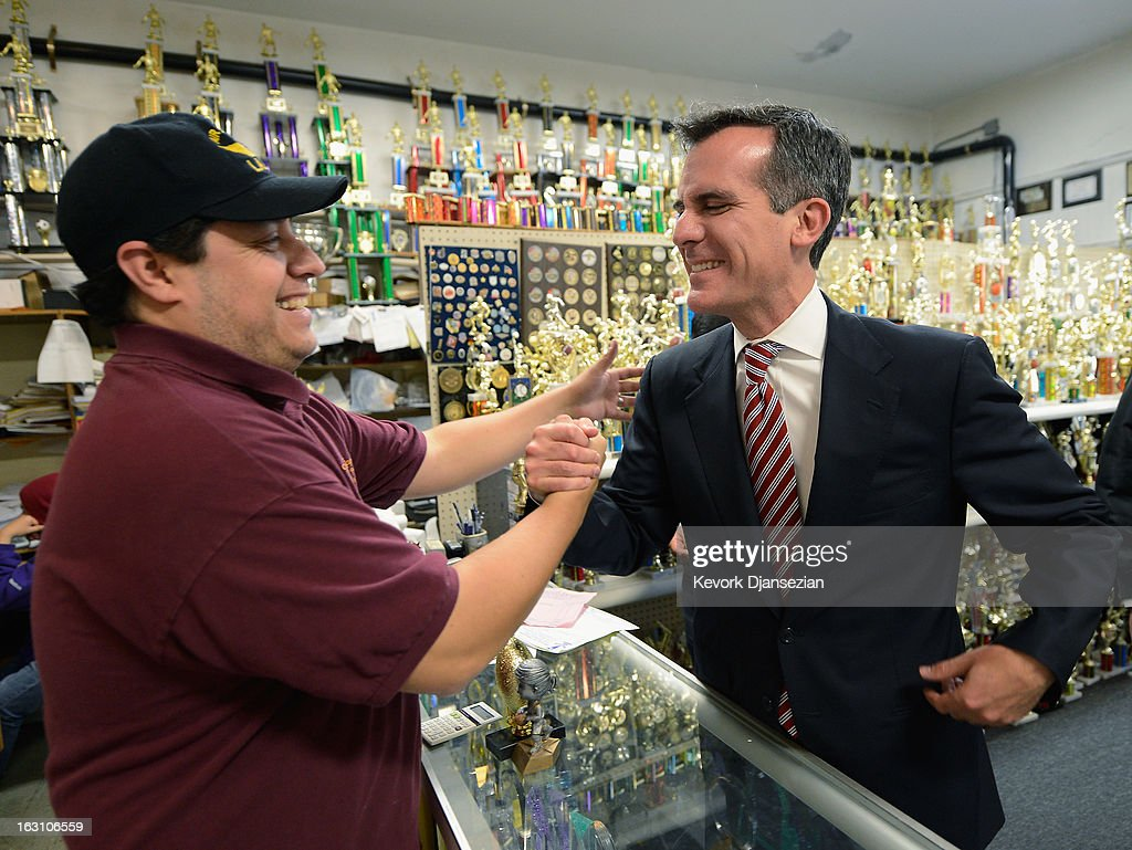 Councilman Eric Garcetti (R), candidate in the Los Angeles City mayoral race, greets Saul Gonzalez of House of Trophies and Awards Inc., visits business around Metro Gold Line's Mariachi Plaza Station during a campaign stop on March 4, 2013 in Los Angeles, California. Garcetti and Los Angeles City Controller Wendy Greueli are locked in a close tie for the lead in the Los Angeles mayoral primary. The top two vote getters will face each other in a run-off election in May.