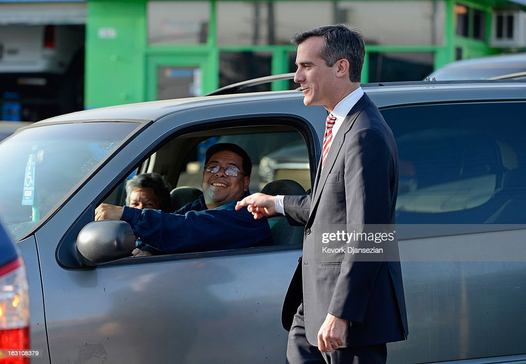 Councilman Eric Garcetti, candidate in the Los Angeles City mayoral race, speaks with motorists as he visits business around Metro Gold Line's Mariachi Plaza Station during a campaign stop on March 4, 2013 in Boyle Heights area Los Angeles, California. Garcetti and Los Angeles City Controller Wendy Greuel are locked in a close tie for the lead in the Los Angeles mayoral primary. The top two vote getters will face each other in a run-off election in May.