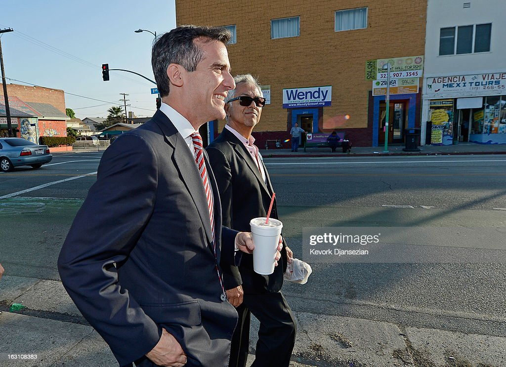 Councilman Eric Garcetti (L), candidate in the Los Angeles City mayoral race, visit busines around Metro Gold Line's Mariachi Plaza Station as he passes across the street from his competitor Controller Wendy Greuel's campaign office during a campaign stop on March 4, 2013 in Boyle Heights area Los Angeles, California. Garcetti and Los Angeles City Controller Wendy Greuel are locked in a close tie for the lead in the Los Angeles mayoral primary. The top two vote getters will face each other in a run-off election in May.