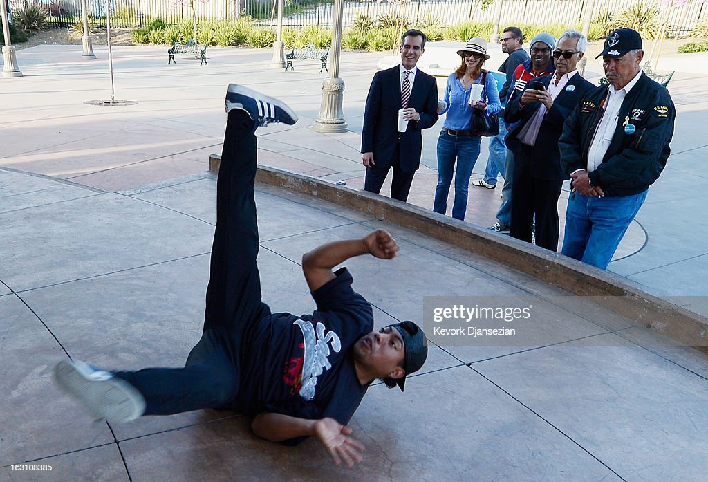 Councilman Eric Garcetti, candidate in the Los Angeles City mayoral race, (C) watches with his entourage as a break dancer performs during a camapaign stop around Metro Gold Line's Mariachi Plaza Station on March 4, 2013 in Boyle Heights area Los Angeles, California. Garcetti and Los Angeles City Controller Wendy Greuel are locked in a close tie for the lead in the Los Angeles mayoral primary. The top two vote getters will face each other in a run-off election in May.