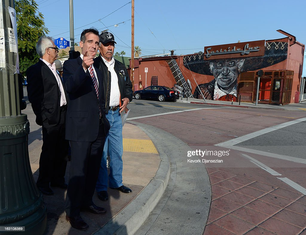 Councilman Eric Garcetti (2nd L), candidate in the Los Angeles City mayoral race, visits business with Tony Zapata (R) around Metro Gold Line's Mariachi Plaza Station during a campaign stop on March 4, 2013 in Boyle Heights area Los Angeles, California. Garcetti and Los Angeles City Controller Wendy Greuel are locked in a close tie for the lead in the Los Angeles mayoral primary. The top two vote getters will face each other in a run-off election in May.