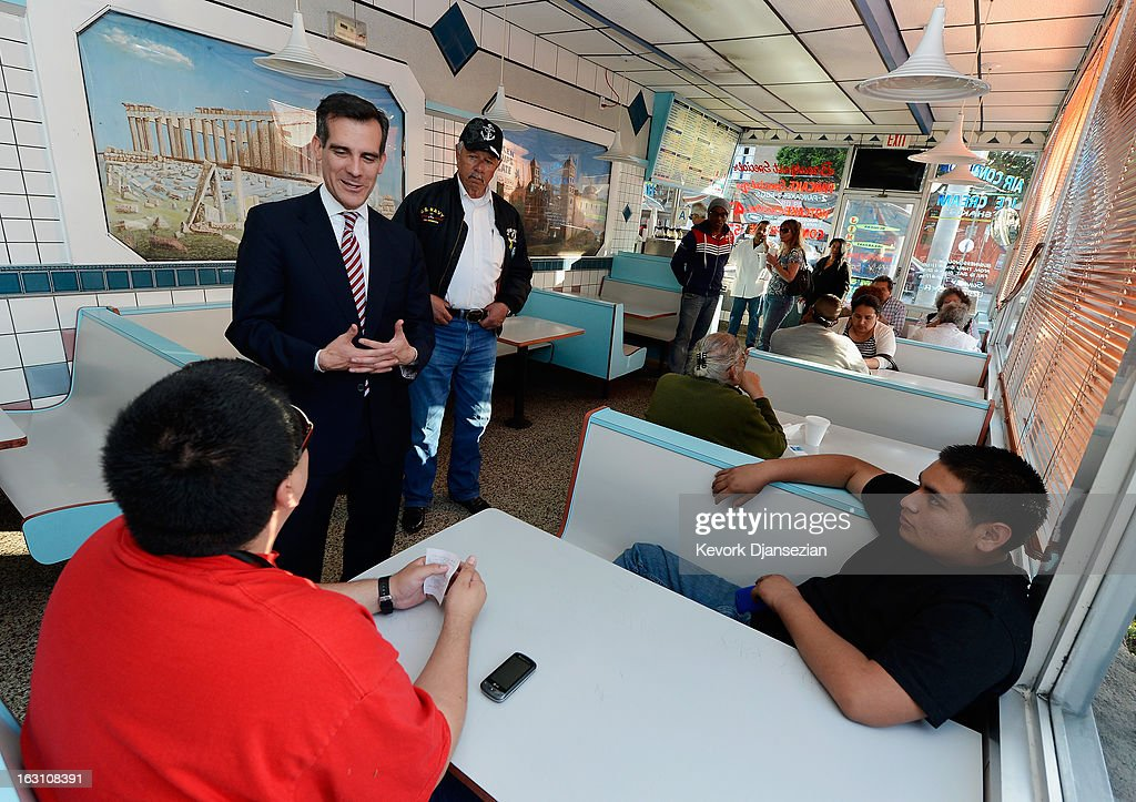 Councilman Eric Garcetti, candidate in the Los Angeles City mayoral race, speaks with patron of Jim's Burger as he visits business around Metro Gold Line's Mariachi Plaza Station during a campaign stop on March 4, 2013 in Boyle Heights area Los Angeles, California. Garcetti and Los Angeles City Controller Wendy Greuel are locked in a close tie for the lead in the Los Angeles mayoral primary. The top two vote getters will face each other in a run-off election in May.