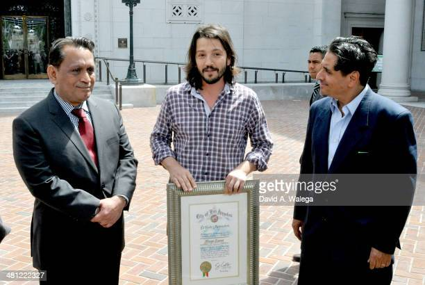 Councilmember Gilbert A Cedillo actor/director Diego Luna and director/writer/producer Richard Montoya with the press after hanging a Huelga banner...