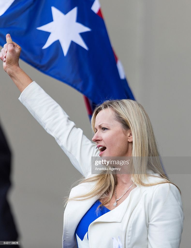 Councilor and Rise Up Australia party member Rosalie Crestani stands in front of the Australian flag during a protest organized by the anti-Islam True Blue Crew supported by the United Patriots Front in Melbourne, Australia on June 26, 2016.