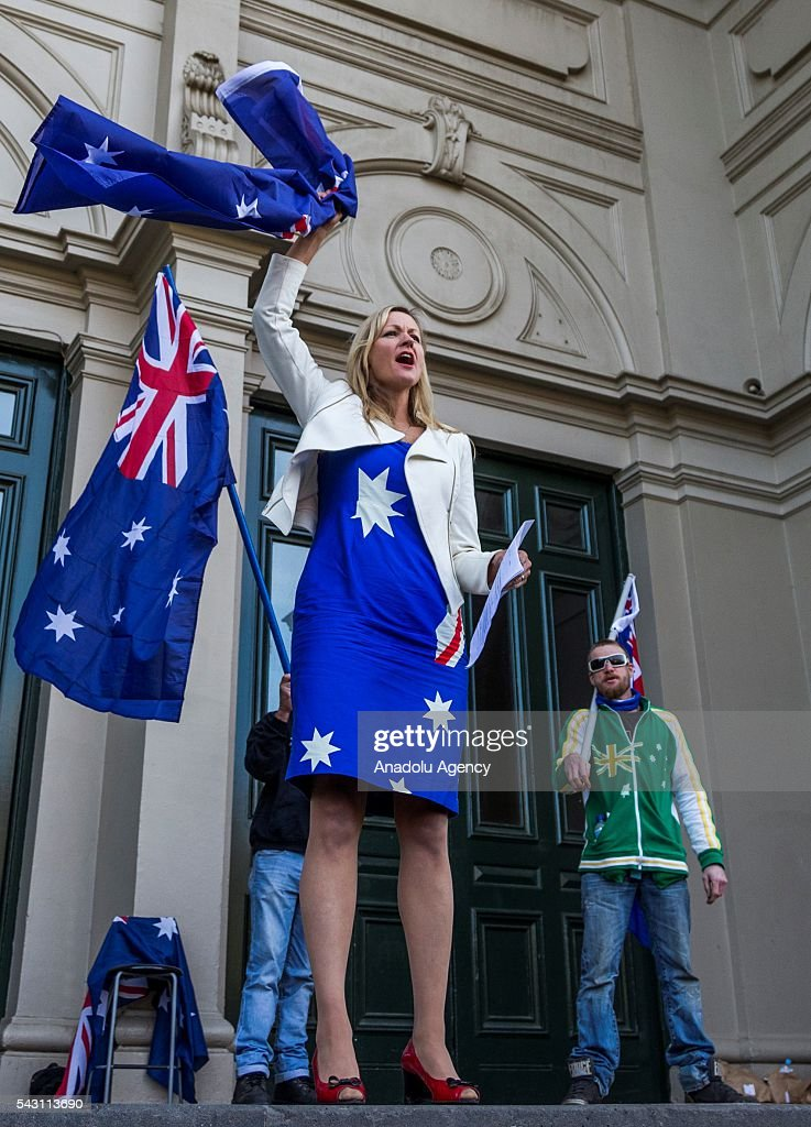 Councilor annd Rise Up Australia party member Rosalie Crestani holds up the Australian Flag as she addresses the crowd during a protest organized by the anti-Islam True Blue Crew supported by the United Patriots Front in Melbourne, Australia on June 26, 2016.
