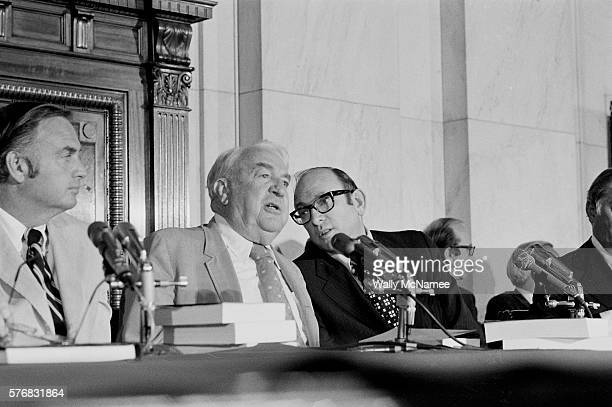 Counsel Sam Dash sits with senators Lowell Weicker and Sam Ervin members of the Senate Watergate Committee during the final report on the Watergate...