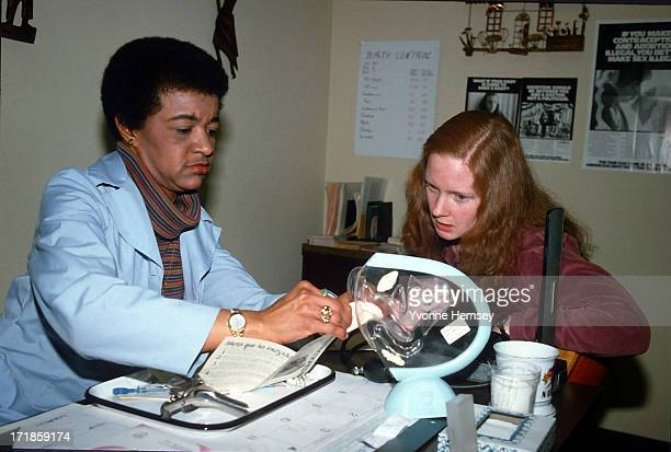 A counselor at a Planned Parenthood clinic in New York City advices a young woman February 3 1988 on the proper way to insert a diaphragm The...