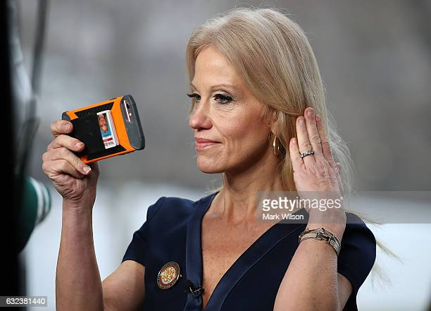 Counselor to President Kellyanne Conway prepares to appear on the Sunday morning show Meet The Press from the north lawn at the White House January...