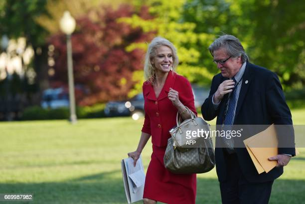 Counselor to the president Kelleyanne Conway and and White House Chief Strategist Stephen Bannon walk across the South Lawn upon return to the White...