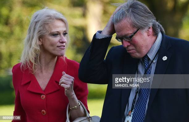Counselor to the president Kelleyanne Conway and White House Chief Strategist Stephen Bannon walk across the South Lawn upon return to the White...