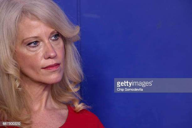 Counselor to the President Kellyanne Conway listens to Office of Management and Budget Director Mick Mulvaney during a news conference to discuss the...