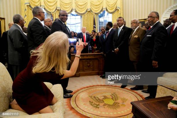 Counselor to the President Kellyanne Conway takes a picture of US President Donald Trump with members of the Historically Black Colleges and...