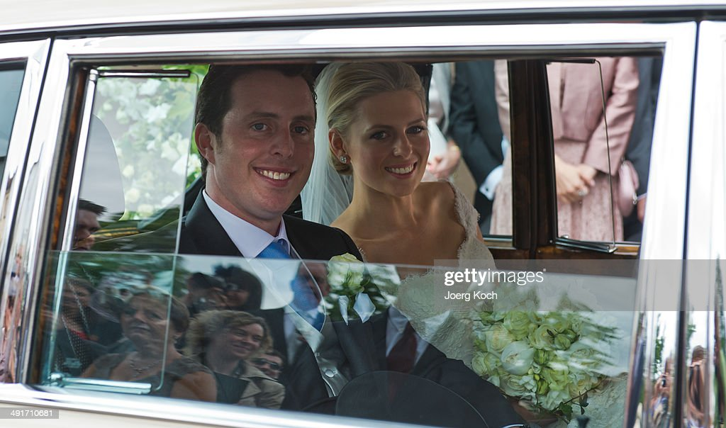 Count Anton Andreas von Faber-Castell and bride Kate Stahl depart Martin-Luther-Church after their wedding on May 17, 2014 in Stein near Nuremberg, Germany.