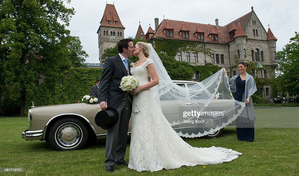 Count Anton Andreas von Faber-Castell and bride Kate Stahl pose in front of Castel Faber-Castell after their wedding on May 17, 2014 in Stein near Nuremberg, Germany.