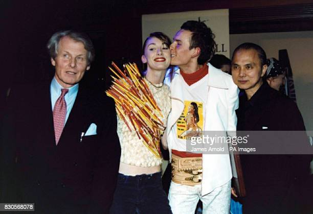 Count Anton Wolfgang von FaberCastell Polish fashion designer Arkadius kissing one of his models and shoe designer Jimmy Choo at the 240th...