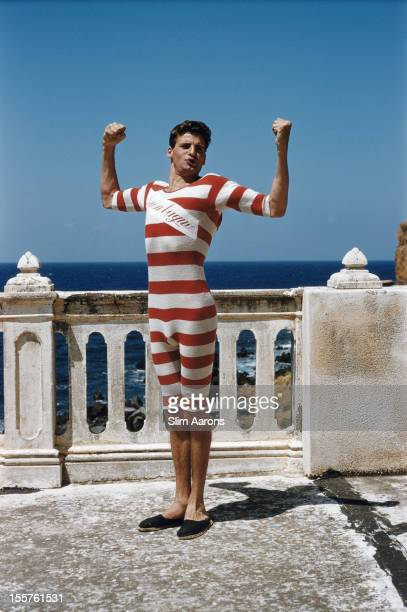 Count Franco Mancinelli Scotti di San Vito poses flexing his biceps in an oldfashioned bathing costume in Sicily Italy 1954