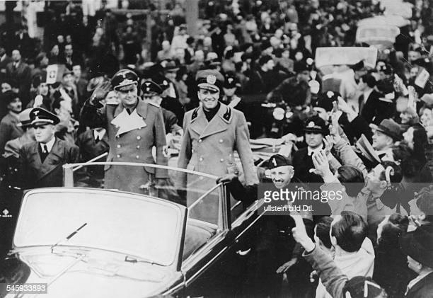 Count Galeazzo Ciano Italian Minister of Foreign Affairs and his German counterpart Joachim Ribbentrop driving through Milan after the preliminary...