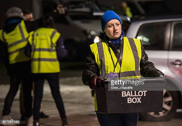 Count staff carry ballot boxes into the Richmond Park byelection count at Richmond Upon Thames College on December 1 2016 in London England Zac...