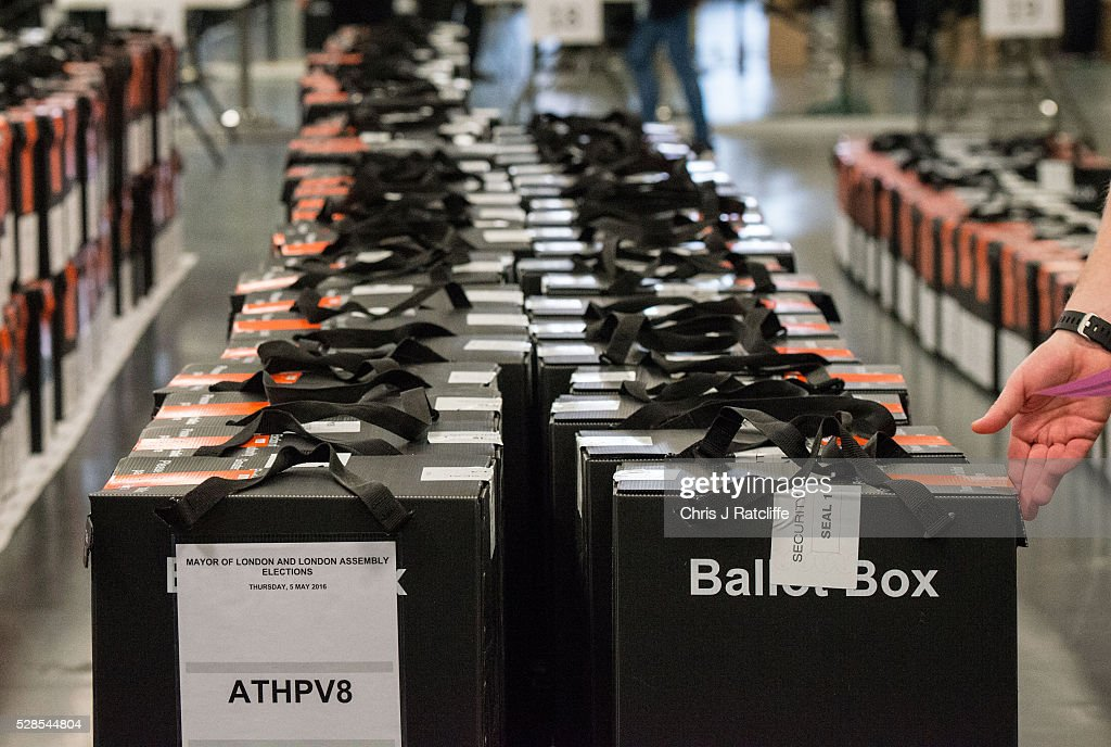 Count staff check seals on unopened ballot boxes as the count begins during the London Mayoral and Assembly election count at Kensington Olympia on May 6, 2016 in London, England. This is the fifth mayoral election since the position was created in 2000. Previous London Mayors are Ken Livingstone for Labour and more recently Boris Johnson for the Conservatives. The main candidates for 2016 are Sadiq Khan, Labour, Zac Goldsmith, Conservative, Suan Berry, Green, Caroline Pidgeon, Liberal Democrat, George Galloway, Respect, Peter Whittle, UKIP and Sophie Walker, Wonmen's Equality Party.