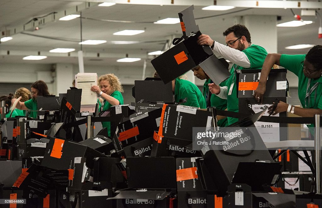 Count staff open ballot boxes and throw the empties onto the floor during the London Mayoral and Assembly election count at Kensington Olympia on May 6, 2016 in London, England. This is the fifth mayoral election since the position was created in 2000. Previous London Mayors are Ken Livingstone for Labour and more recently Boris Johnson for the Conservatives. The main candidates for 2016 are Sadiq Khan, Labour, Zac Goldsmith, Conservative, Suan Berry, Green, Caroline Pidgeon, Liberal Democrat, George Galloway, Respect, Peter Whittle, UKIP and Sophie Walker, Wonmen's Equality Party.