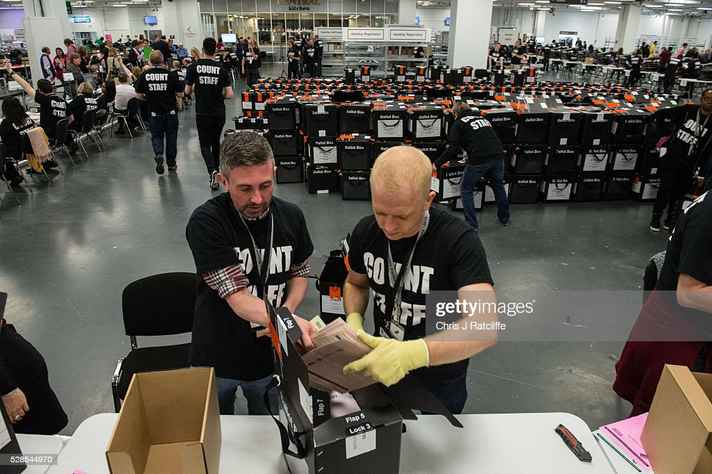 Count staff open up ballot boxes during the London Mayoral and Assembly election count at Kensington Olympia on May 6, 2016 in London, England. This is the fifth mayoral election since the position was created in 2000. Previous London Mayors are Ken Livingstone for Labour and more recently Boris Johnson for the Conservatives. The main candidates for 2016 are Sadiq Khan, Labour, Zac Goldsmith, Conservative, Suan Berry, Green, Caroline Pidgeon, Liberal Democrat, George Galloway, Respect, Peter Whittle, UKIP and Sophie Walker, Wonmen's Equality Party.