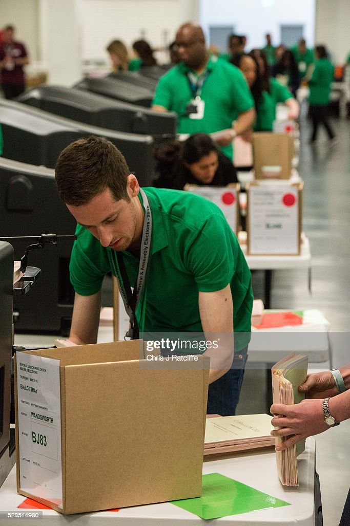Count staff put ballot papers through counting machines during the London Mayoral and Assembly election count at Kensington Olympia on May 6, 2016 in London, England. This is the fifth mayoral election since the position was created in 2000. Previous London Mayors are Ken Livingstone for Labour and more recently Boris Johnson for the Conservatives. The main candidates for 2016 are Sadiq Khan, Labour, Zac Goldsmith, Conservative, Suan Berry, Green, Caroline Pidgeon, Liberal Democrat, George Galloway, Respect, Peter Whittle, UKIP and Sophie Walker, Wonmen's Equality Party.