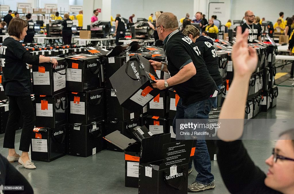 Count staff stack opened and empty ballot boxes as another puts her hand in the air signaling they are ready for more ballot papers during the London Mayoral and Assembly election count at Kensington Olympia on May 6, 2016 in London, England. This is the fifth mayoral election since the position was created in 2000. Previous London Mayors are Ken Livingstone for Labour and more recently Boris Johnson for the Conservatives. The main candidates for 2016 are Sadiq Khan, Labour, Zac Goldsmith, Conservative, Suan Berry, Green, Caroline Pidgeon, Liberal Democrat, George Galloway, Respect, Peter Whittle, UKIP and Sophie Walker, Wonmen's Equality Party.