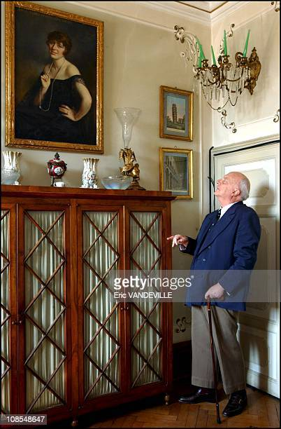 Count TadiniBuoninsegniTobler admiring a portrait of his mother in Pisa Italy in March 2002